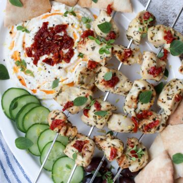 platter with chicken kabobs and whipped feta