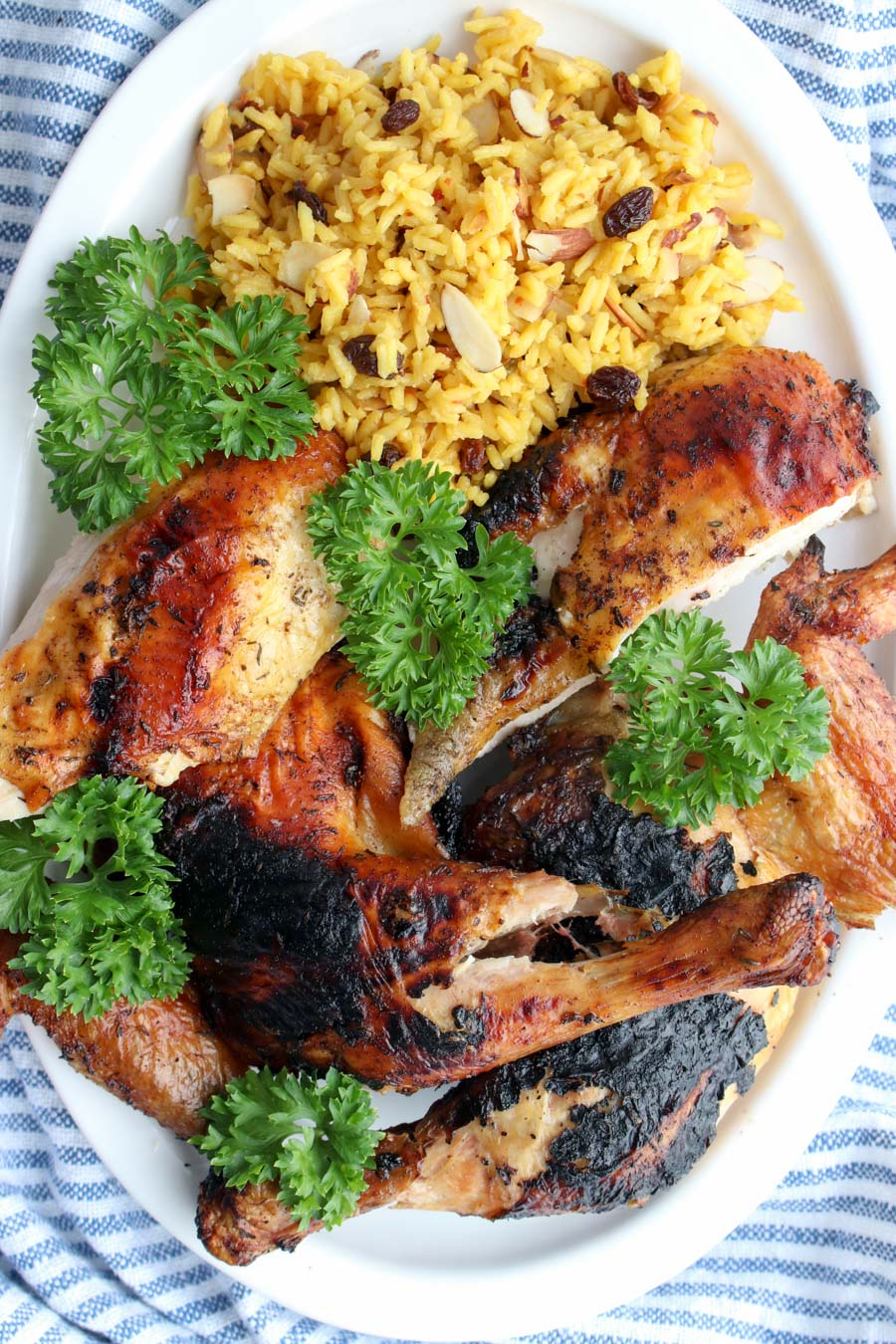 grilled chicken on a platter with yellow rice