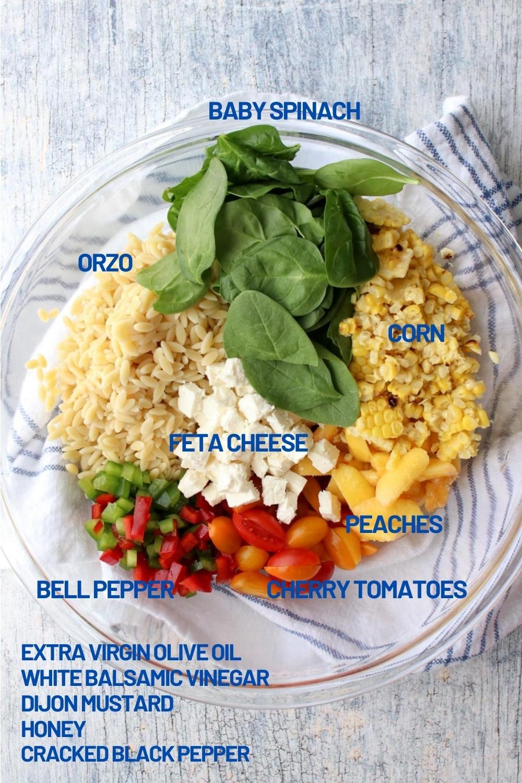 large bowl of orzo salad ingredients