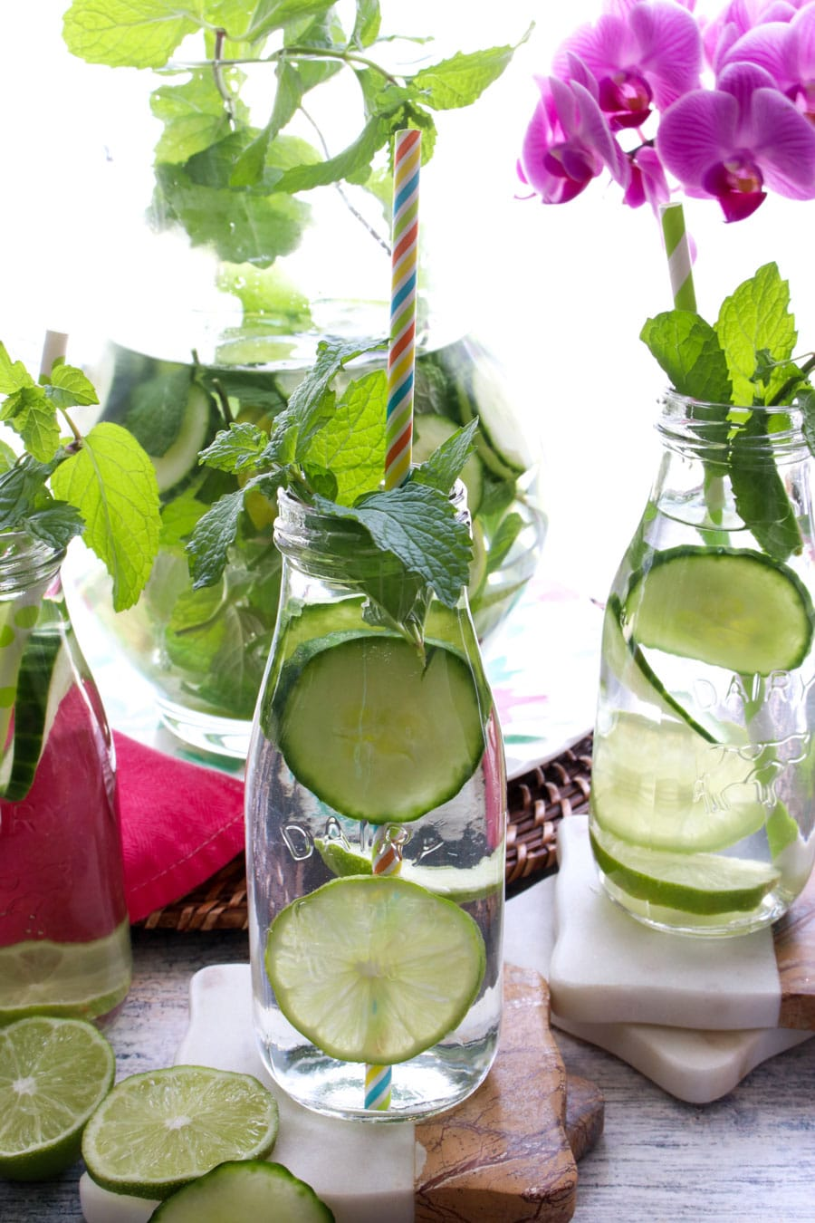 milk bottles of water with cucumber and mint