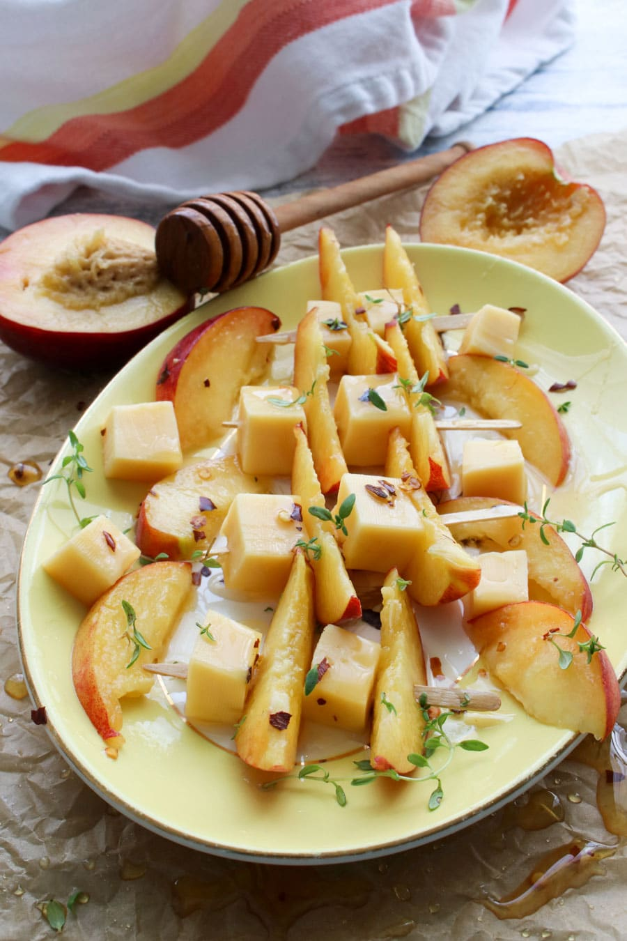 Skewers of gouda cheese, peach slices, and hot honey