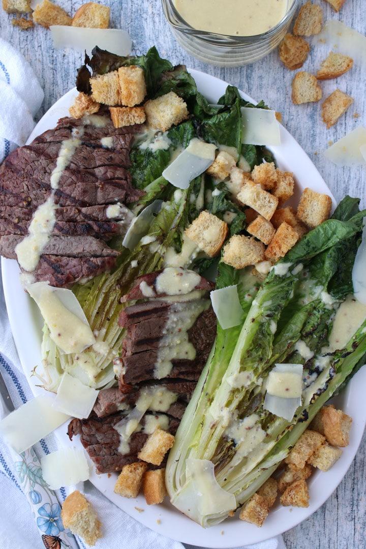 Cesar Steak Salad on white Platter