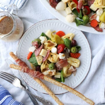 antipasto salad on a small round plate