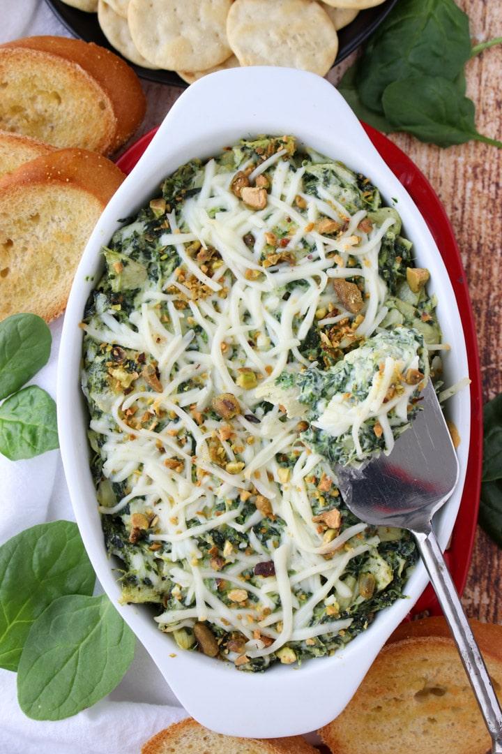 casserole dish with spinach artichoke  dip