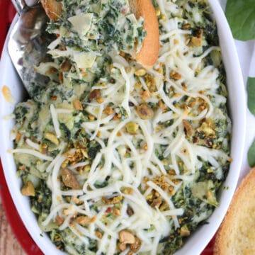 casserole dish with hot spinach artichoke dip