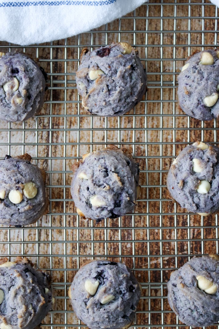 cooling rack with purple blueberry cookies