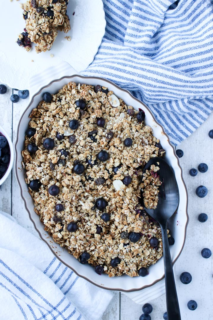 White casserole dish with baked blueberry oatmeal